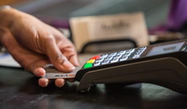 Customer using a card at a POS.