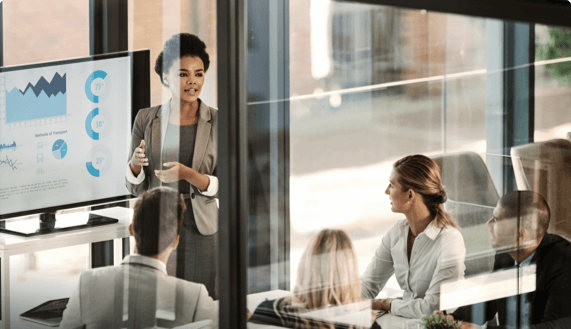 Woman in conference room standing and giving presentation